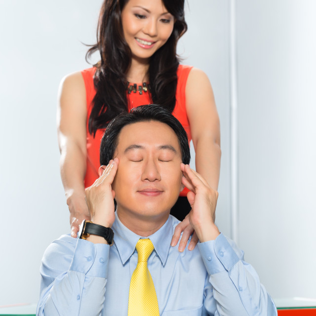 """Asian Colleagues having office affair"" stock image"