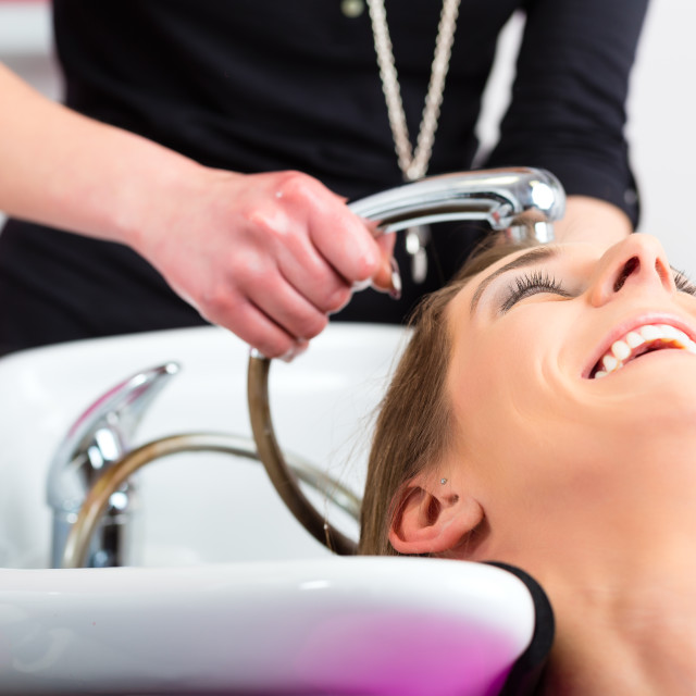 """""""Woman at the hairdresser washing hair"""" stock image"""