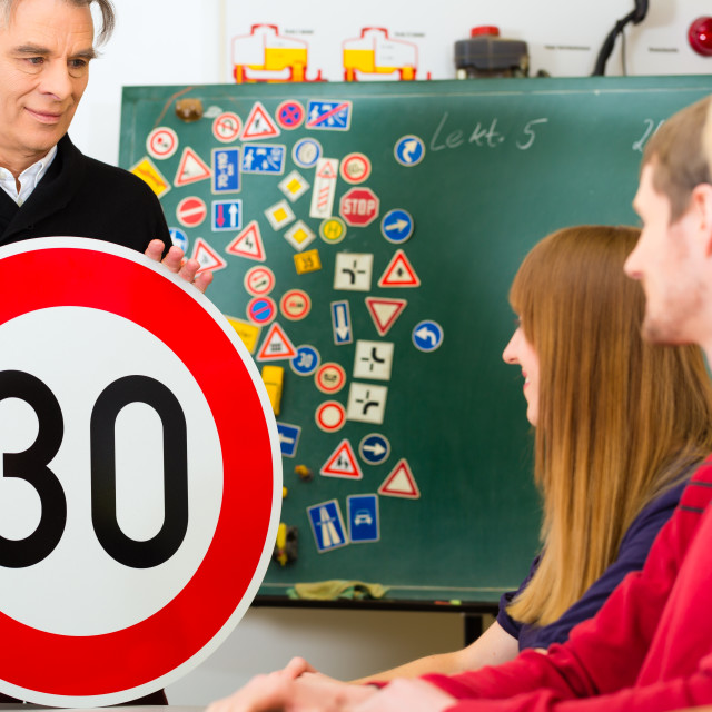 """Driving instructor with his class"" stock image"