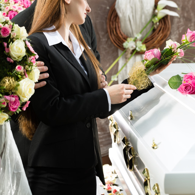 """Mourning People at Funeral with coffin"" stock image"