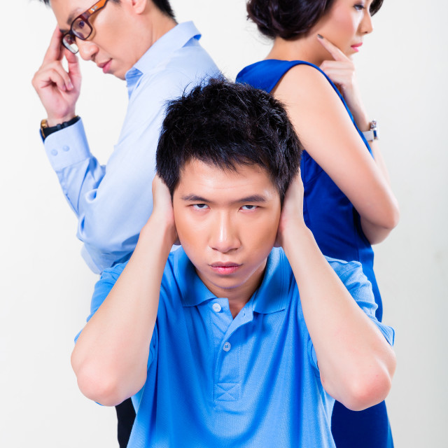 """Young Chinese boy suffering from parents divorce"" stock image"