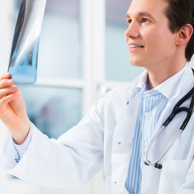 """""""Competent doctor analyzes x-ray image"""" stock image"""
