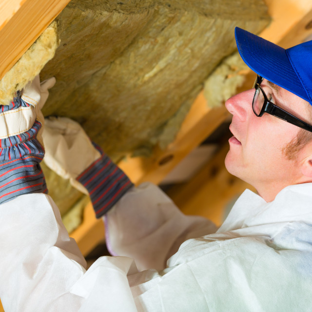 """Worker setting thermal insulating material"" stock image"