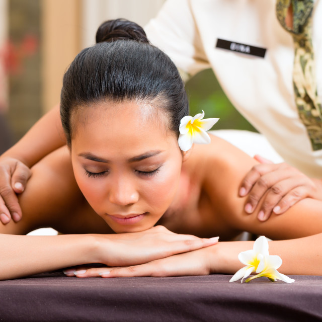 """Indonesian woman wellness massage in spa"" stock image"