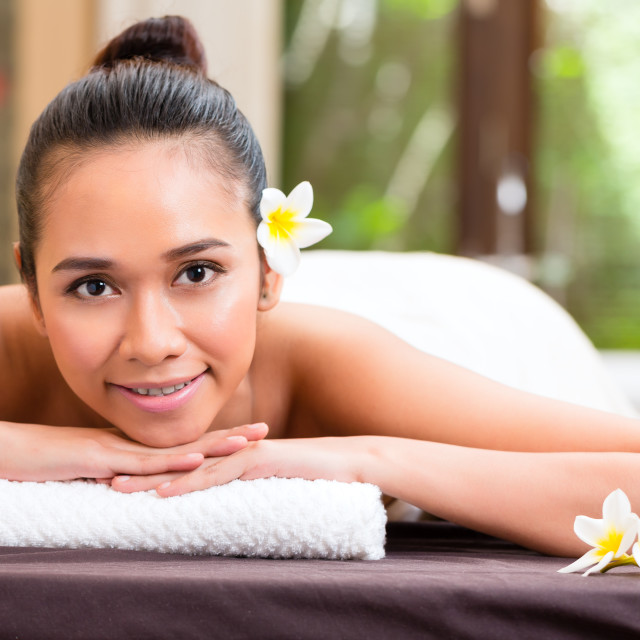 """Indonesian woman having wellness massage"" stock image"