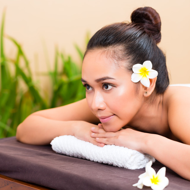 """Indonesian woman in wellness day spa"" stock image"