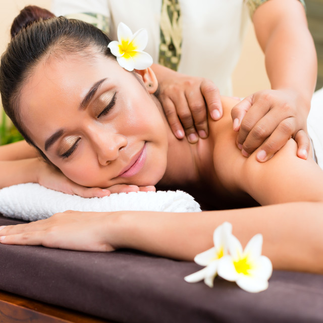"""Indonesian Asian woman at wellness massage"" stock image"