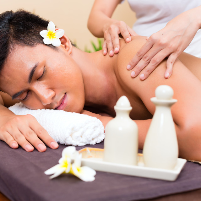 """Indonesian Asian man at wellness massage"" stock image"