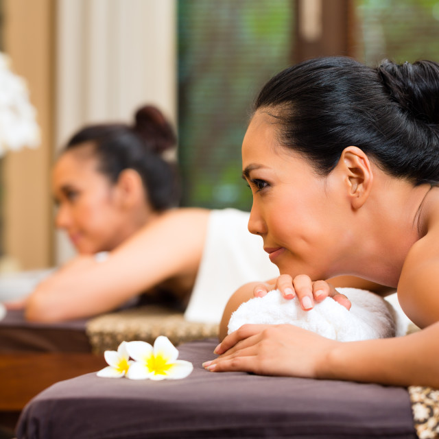 """Two Indonesian women having wellness massage"" stock image"