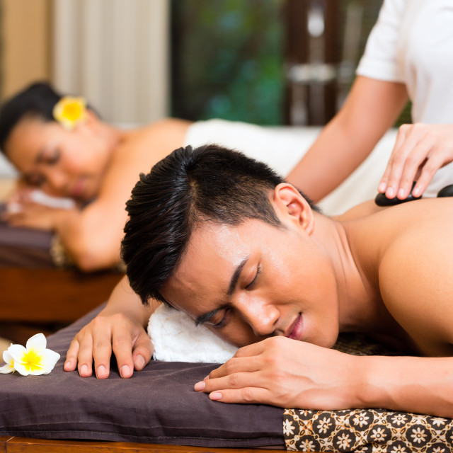 """Indonesian couple having wellness massage"" stock image"