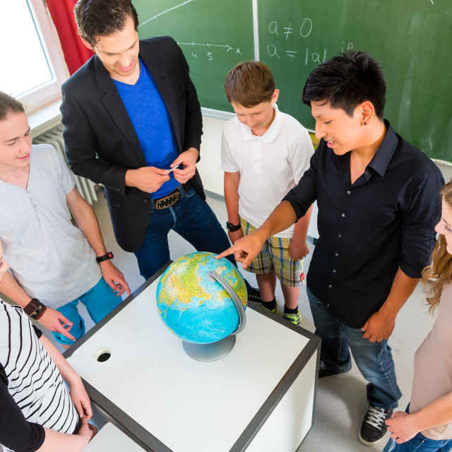 """Teacher teaching students geography lessons in school"" stock image"