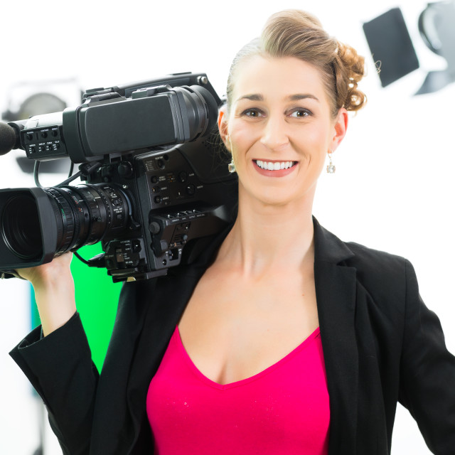 """""""Camerawoman shooting with camera on film set"""" stock image"""