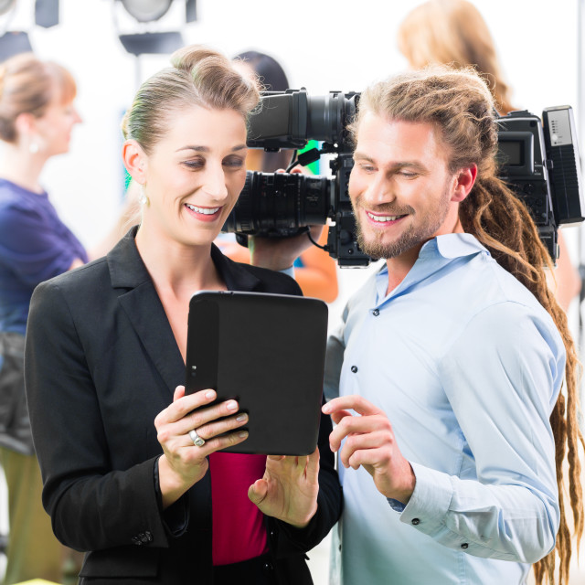 """""""Director giving cameraman direction for video production"""" stock image"""
