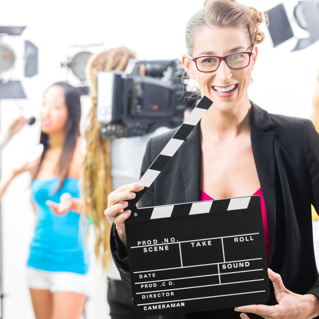 """""""Woman with take clap at video production on film set"""" stock image"""