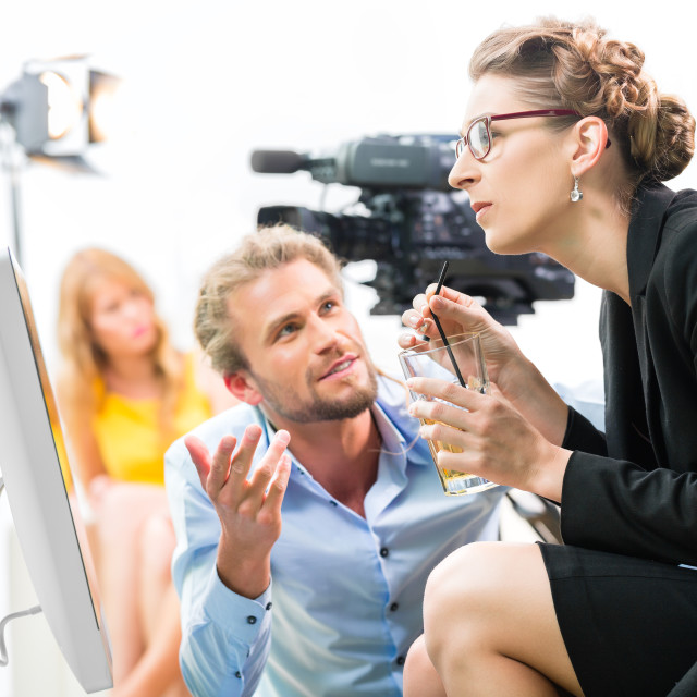 """""""Film team discussing direction for video production"""" stock image"""