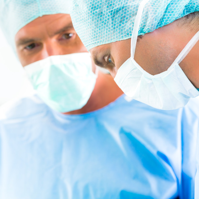 """Surgeons or doctors in operating room of hospital"" stock image"