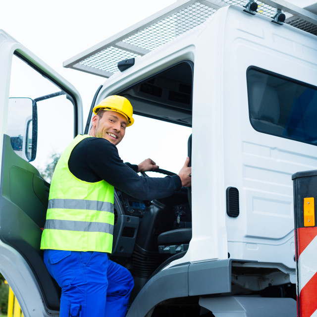 """""""crane operator driving with truck of construction site"""" stock image"""
