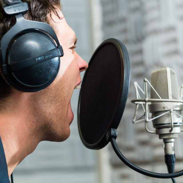 """Male Singer or musician for recording in Studio"" stock image"