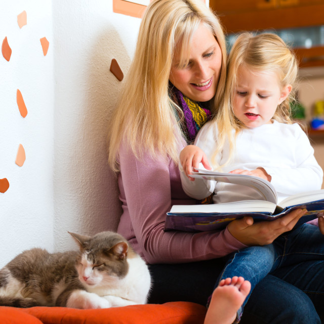 """""""Mother reading night story to kid at home"""" stock image"""