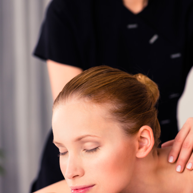 """Massager giving woman wellness spa massage"" stock image"