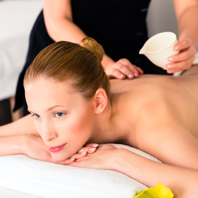 """Woman having wellness massage in spa with oil"" stock image"