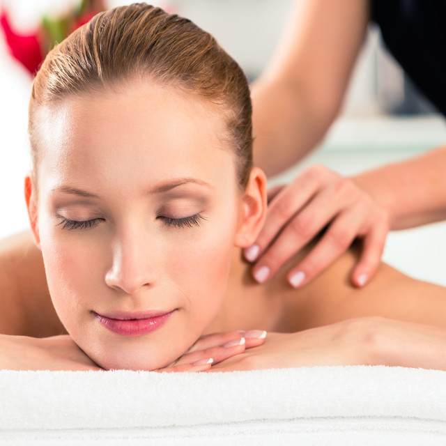 """Woman having wellness massage in spa"" stock image"