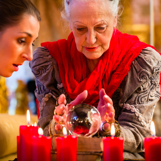 """""""Soothsayer with crystal ball and client"""" stock image"""