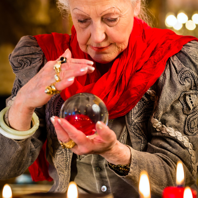 """""""Soothsayer during session with crystal ball"""" stock image"""