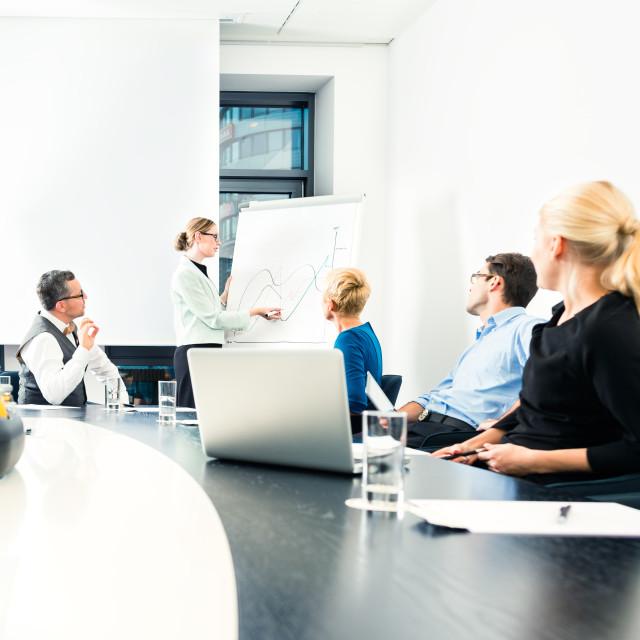 """Business - team presentation on whiteboard"" stock image"
