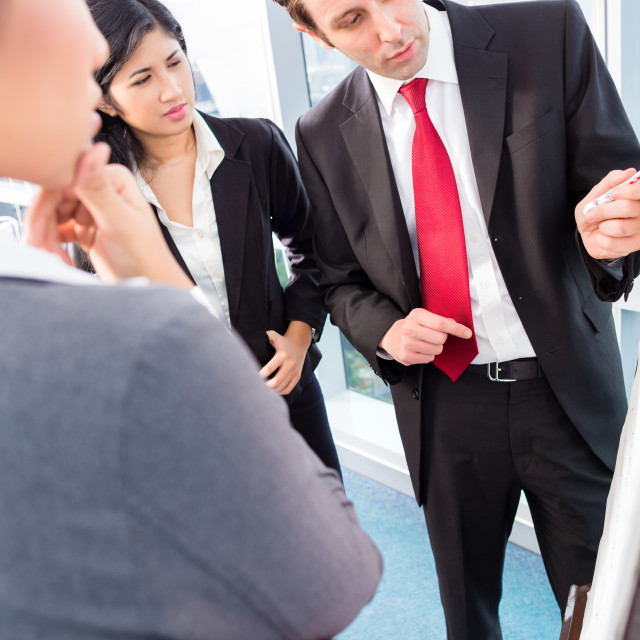 """Business team drafting in strategy meeting"" stock image"