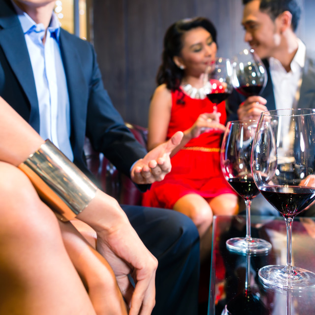 """""""Asian Friends drinking wine in bar"""" stock image"""