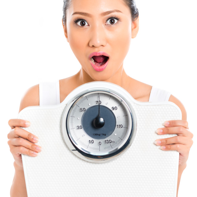 """Asian woman with weight scale losing weight"" stock image"