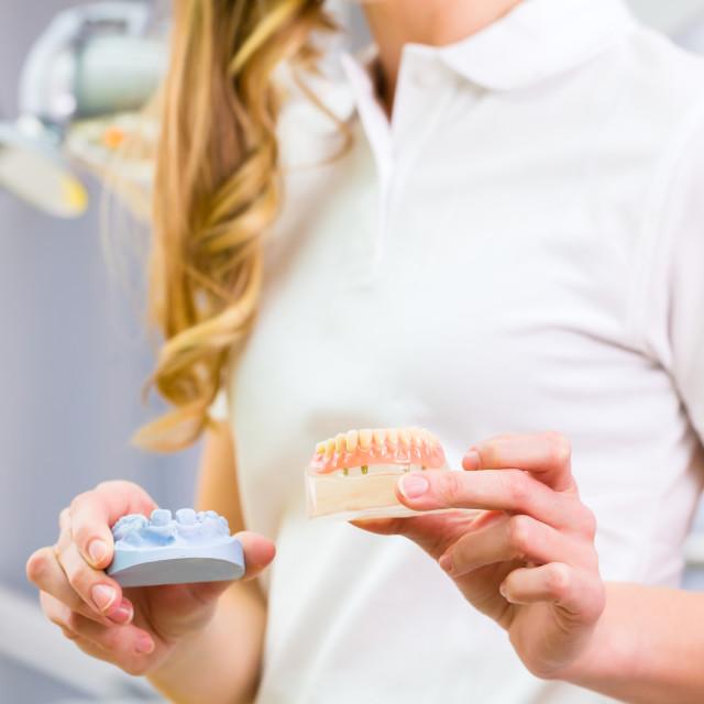 """Dental technician checking denture"" stock image"
