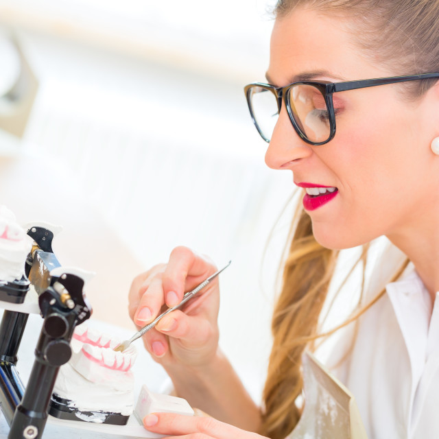 """Dental technician producing denture"" stock image"