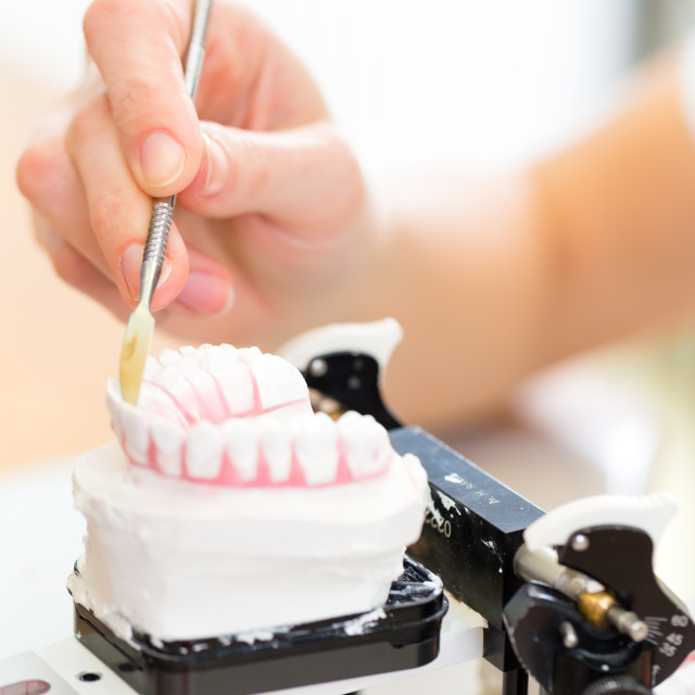 """Dental technician producing denture"" stock image"