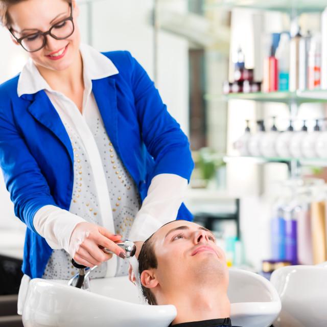 """""""Hairdresser washing man hair in barbershop"""" stock image"""