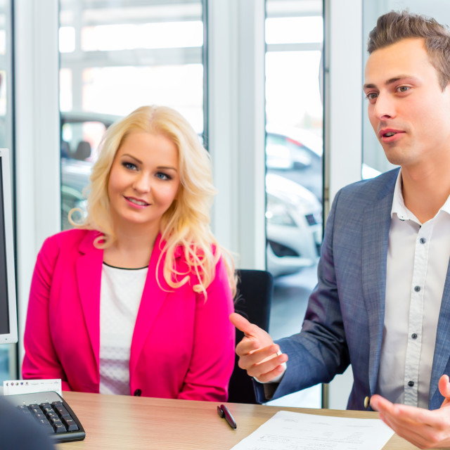 """""""Couple negotiating sale contact for car"""" stock image"""
