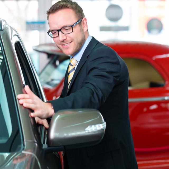 """Salesman selling car at dealership"" stock image"