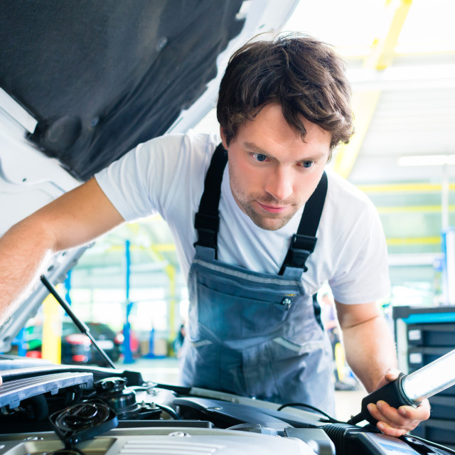 """Auto mechanic working in car service workshop"" stock image"