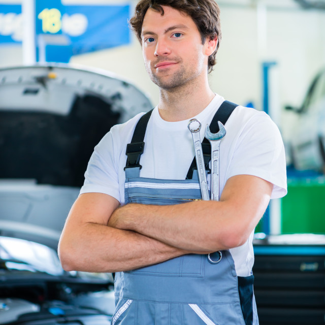 """Mechanic working in car workshop"" stock image"