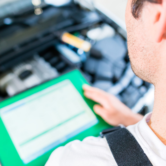 """""""Mechanic with diagnostic tool in car workshop"""" stock image"""