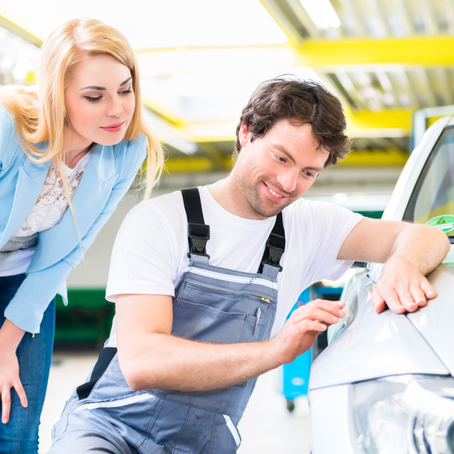 """Customer and car painter in auto workshop"" stock image"