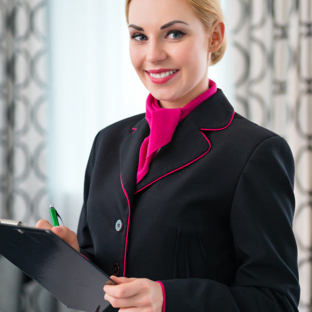 """Housekeeper checking hotel suite"" stock image"