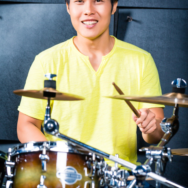 """Asian musician drummer in recording studio"" stock image"