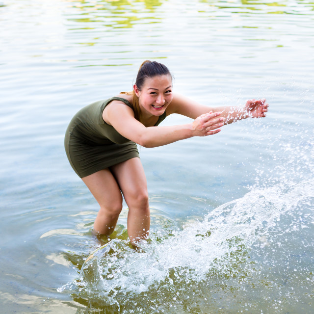 """Woman romping cheerful in lake water"" stock image"