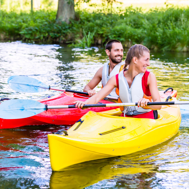 """""""Friends going down river in sport canoe"""" stock image"""