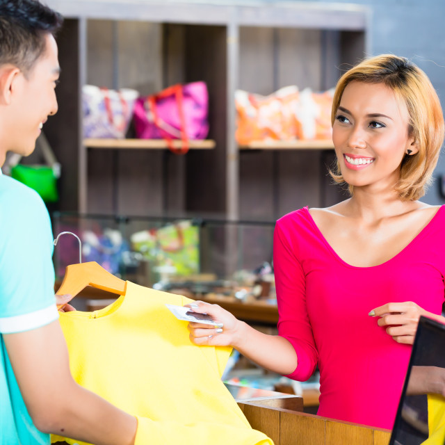 """""""Asian woman paying purchase in fashion store"""" stock image"""