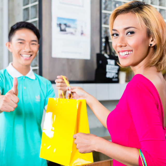 """Customer and shop assistant in fashion store"" stock image"