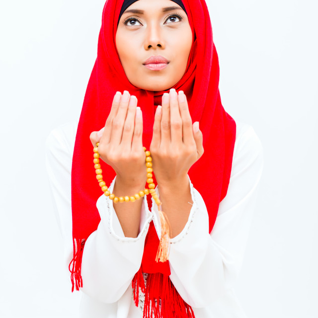 """Asian Muslim woman praying with beads chain"" stock image"