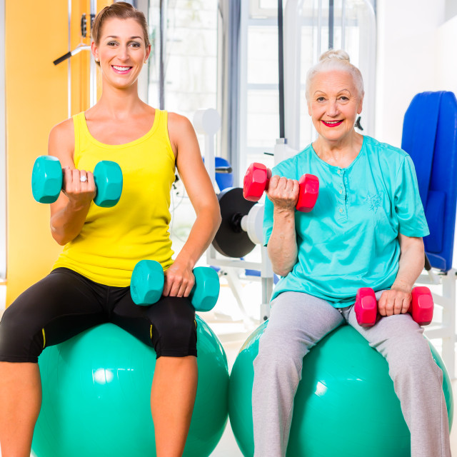 """""""Two women doing strength sport in fitness gym"""" stock image"""